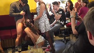 Sexy slave knows hot to work crowd in public