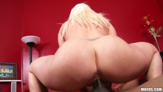 Busty babe Kaylee Brookshire blows black rod and rides it on top