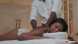 Mandingo fucks beautiful black client Nia Nacci on the massage table